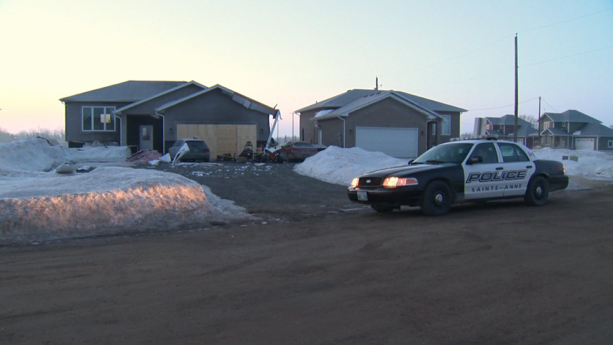 Police say an explosion at this Ste. Anne house Sunday afternoon was caused by butane used to produce drugs.