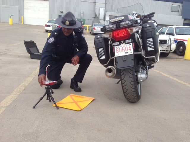 EPS officer tests a motorcycle for noise violations May 21, 2014.