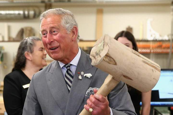Prince Charles, Prince of Wales hammers in a peg with a giant mallet as he visits the woodwork department at the centre for applied science and technology at Holland College on Tuesday in Charlottetown. The Prince of Wales and Duchess of Cornwall will arrive in Winnipeg on Tuesday evening.