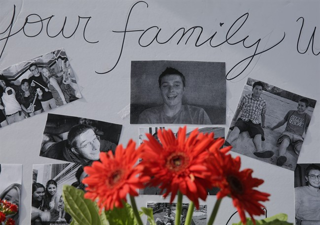 Images of Christopher Martinez are displayed as part of a memorial in front of the IV Deli Mart, where part of Friday night's mass shooting took place, on Sunday, May 25, 2014, in the Isla Vista beach community of Santa Barbara, Calif.