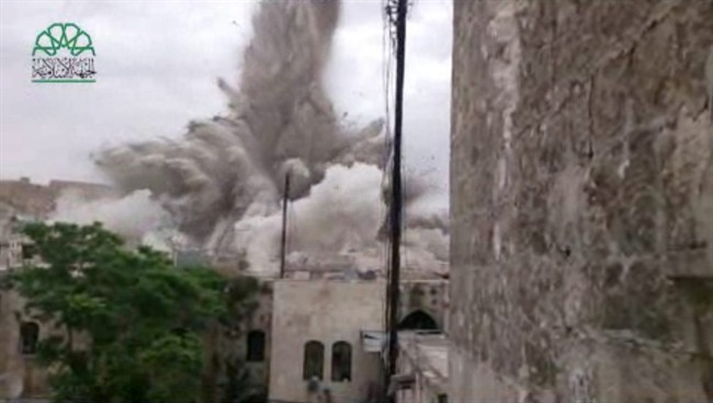 This image made from amateur video posted by Shaam News Network (SNN), an anti-Bashar Assad activist group, which has been verified and is consistent with other AP reporting, shows an explosion that destroyed the Carlton Hotel in Aleppo, Syria, Thursday, May 8, 2014.