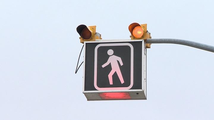 FILE - A crosswalk light.