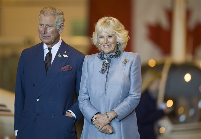 Prince Charles and wife Camilla look on in Winnipeg on Wednesday, May 21, 2014. The royal pair will be returning to Canada this summer.