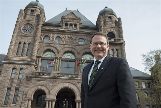 Green Party leader Mike Schreiner poses for a photo in front of the Ontario Legislature in Toronto on Wednesday May 7, 2014.
