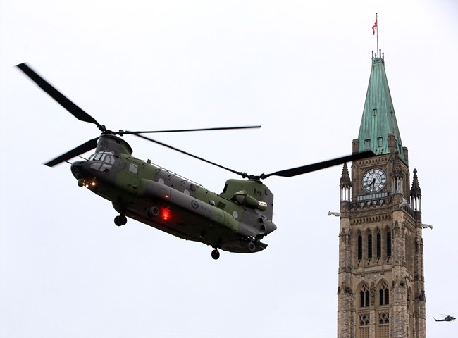A Canadian Forces CH-147 Chinook helicopter prepares to land on Parliament Hill in preparation for Canada's National Day of Honour.