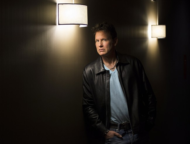80's pop star Corey Hart poses for a photograph in Montreal, Monday, May 19, 2014.