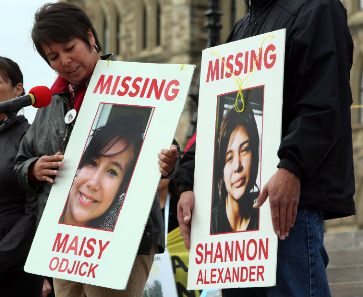 Laurie Odjick holds a sign with photo of her missing daughter, Maisy, who went missing along with Shannon Alexander in 2008 at age 16. Odjick was taking part in a rally on Parliament Hill in Ottawa on Friday, October 4, 2013 by the Native Women's Assoiciation of Canada honouring the lives of missing and murdered Aboriginal women and girls.