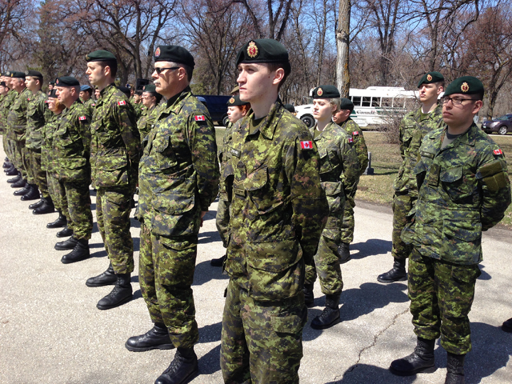 Military members participate in the National Day of Honour at Brookside Cemetery in Winnipeg on Friday to mark the end of Canada's mission in Afghanistan.