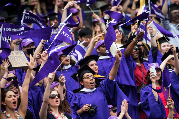 Students celebrate at the commencement of the 2014 New York University graduation ceremony at Yankee Stadium on May 21, 2014 in the Bronx borough of New York City.