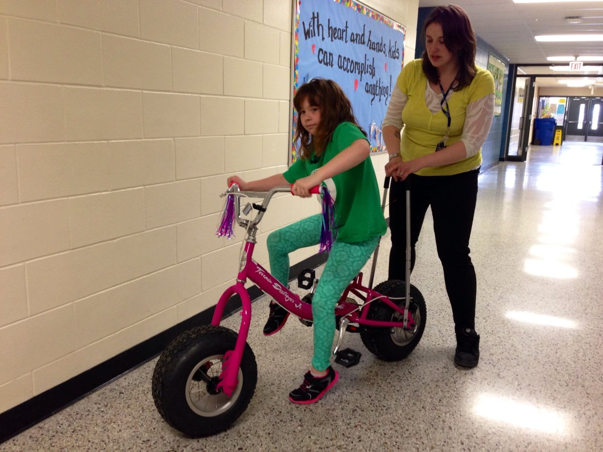 Arabella Keam has cerebral palsy and is learning how to ride a bike thanks to a modified bicycle.