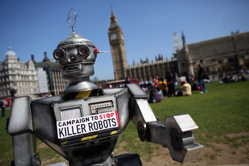 A robot distributes promotional literature calling for a ban on fully autonomous weapons in Parliament Square on April 23, 2013 in London, England. The 'Campaign to Stop Killer Robots' is calling for a pre-emptive ban on lethal robot weapons that could attack targets without human intervention. (Photo by Oli Scarff/Getty Images).