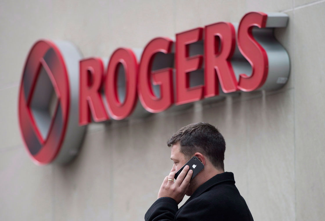 A man speaks on a mobile phone outside Rogers Communications Inc.'s annual general meeting of shareholders in Toronto on Tuesday, April 22, 2014