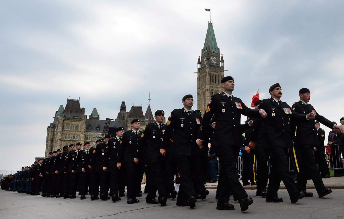 Canadian Forces members parade from Parliament Hill during the National Day of Honour in Ottawa on Friday, May 9, 2014. THE CANADIAN PRESS/Sean Kilpatrick.