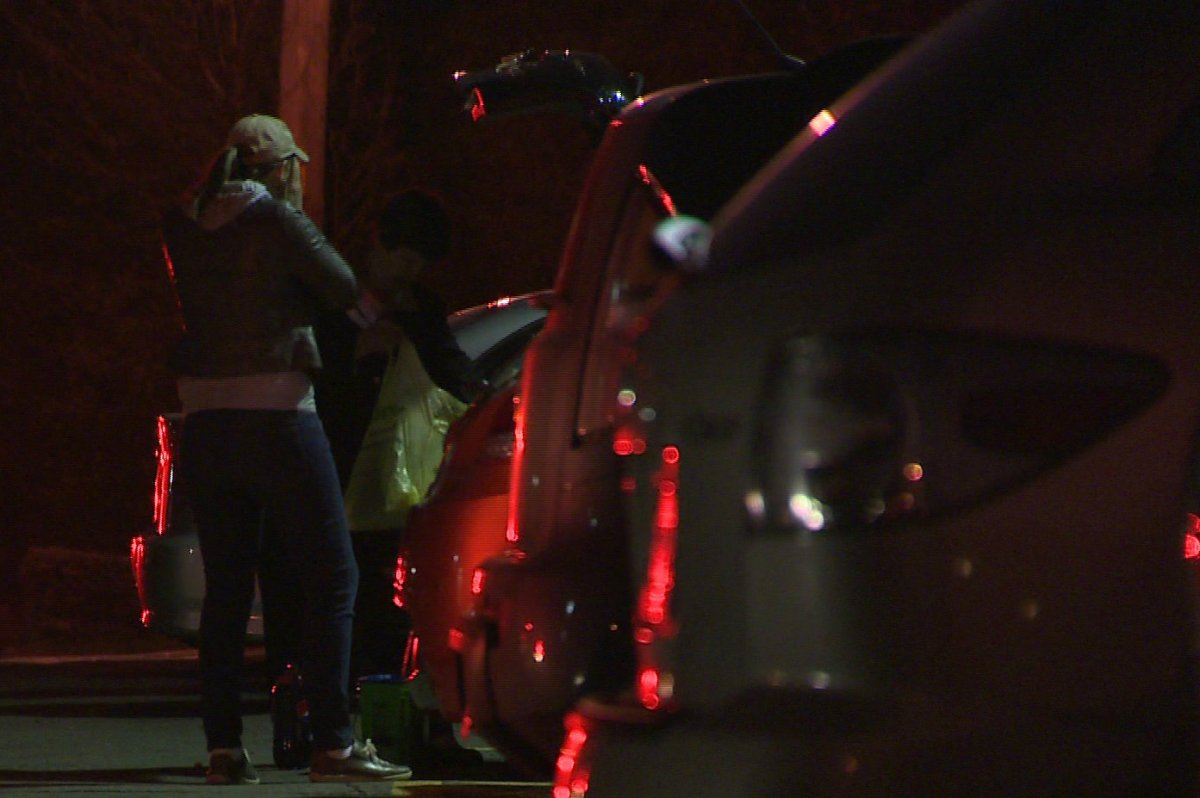 Residents of a Dartmouth apartment building pack up belongings they salvaged after a fire.