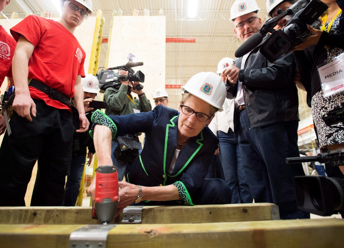 Ontario Liberal Leader Kathleen Wynne practices using a drill during a campaign stop at the Carpenters' Union Local 27 Training Centre in Vaughan, Ont. on Monday, May 12, 2014.