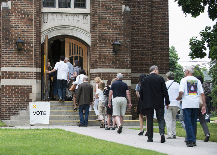 Voters flock to a poll in Toronto's west end, June 12, 2014.