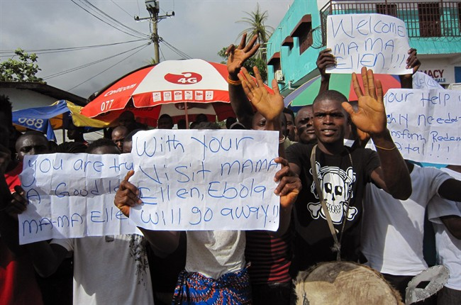 People protest outside a hospital as Liberia President Ellen Johnson Sirleaf visits the area after Ebola deaths in Monrovia, Liberia, Tuesday, June 17, 2014.
