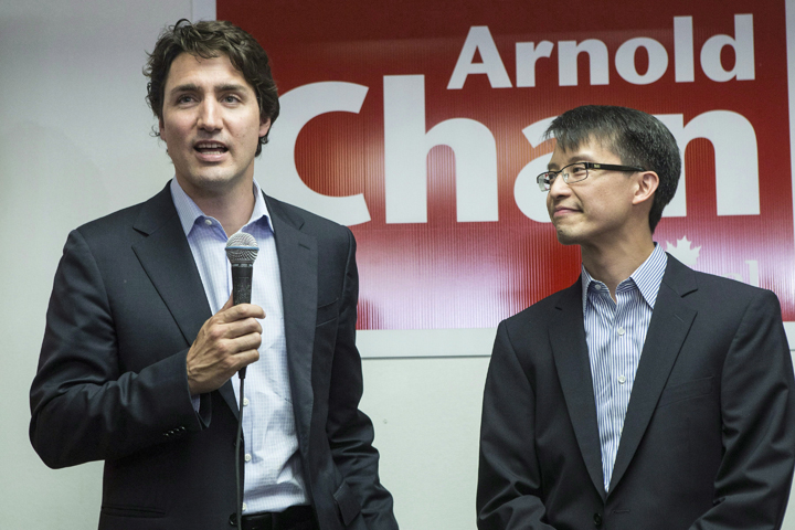 Federal Liberal Leader Justin Trudeau speaks to supporters as he visits Liberal candidate for Scarborough-Agincourt Arnold Chan (right) at his campaign office in Toronto on Wednesday, May 21 , 2014.