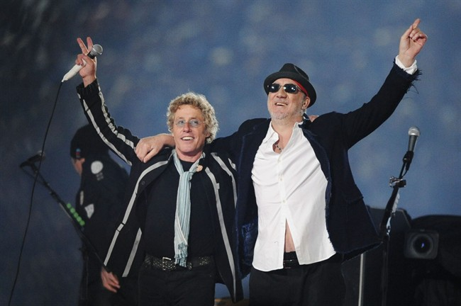 Roger Daltrey, left, and Pete Townshend acknowledge the crowd after performing at the Super Bowl in 2010. Townshend and Daltrey are taking the band on the road to celebrate The Who's 50th anniversary.