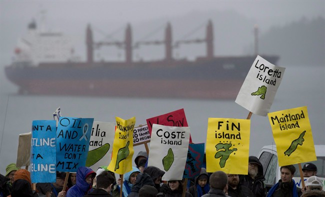 A group of protesters gathers outside the Northern Gateway hearings in Prince Rupert, B.C. Monday, December, 10, 2012. The proposed 1,177-kilometre twin pipelines would run from Bruderheim, just outside Edmonton, to a tanker port in Kitimat, on the northern coast of B.C.