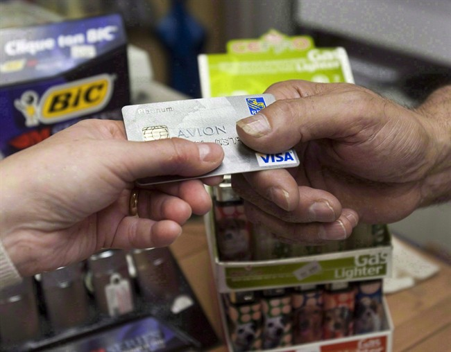 A consumer pays with a credit card at a store in Montreal on July 6, 2010.