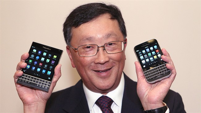 BlackBerry CEO John Chen shows off the new Passport (left) and Classic phone models after the company's Annual General Meeting in Waterloo, Ont., Thursday June 19, 2014.