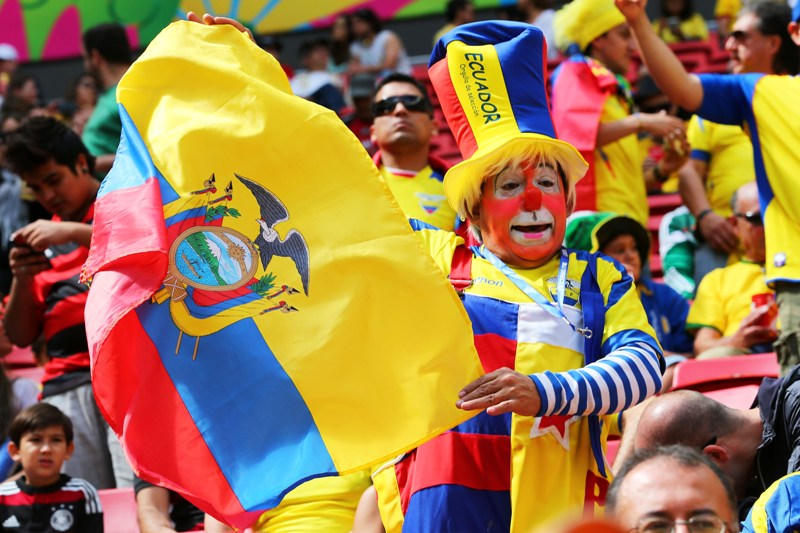 An Ecuador fan cheers prior to the 2014 FIFA World Cup Brazil Group E match between Switzerland and Ecuador at Estadio Nacional on June 15, 2014 in Brasilia, Brazil. (Photo by Clive Brunskill/Getty Images).