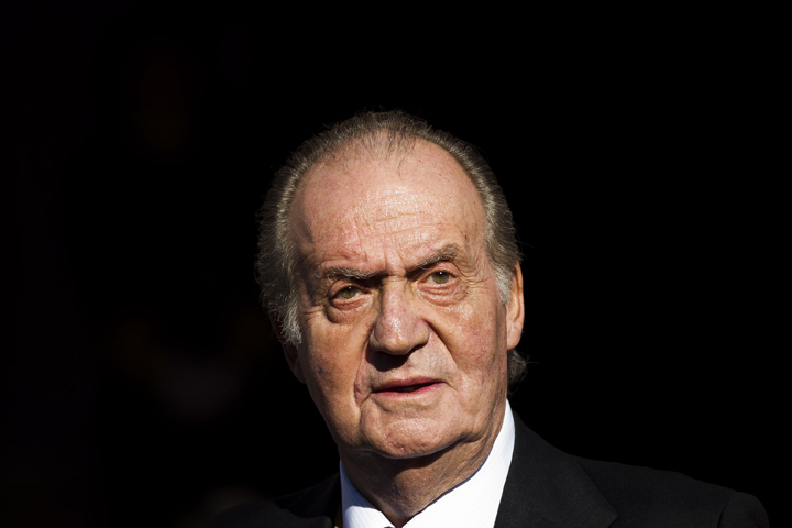 In this Tuesday, Dec. 27, 2011, file photo Spain's King Juan Carlos leaves after the official opening of the Parliament, in Madrid.