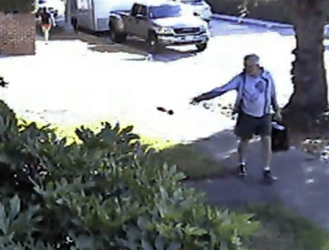 FILE - In this June 7, 2014 file image from from a security video provided by Philip Lao, San Marino Mayor Dennis Kneier tosses a bag of dog waste onto the property of a political rival. (AP Photo/Courtesy Philip Lao, File).