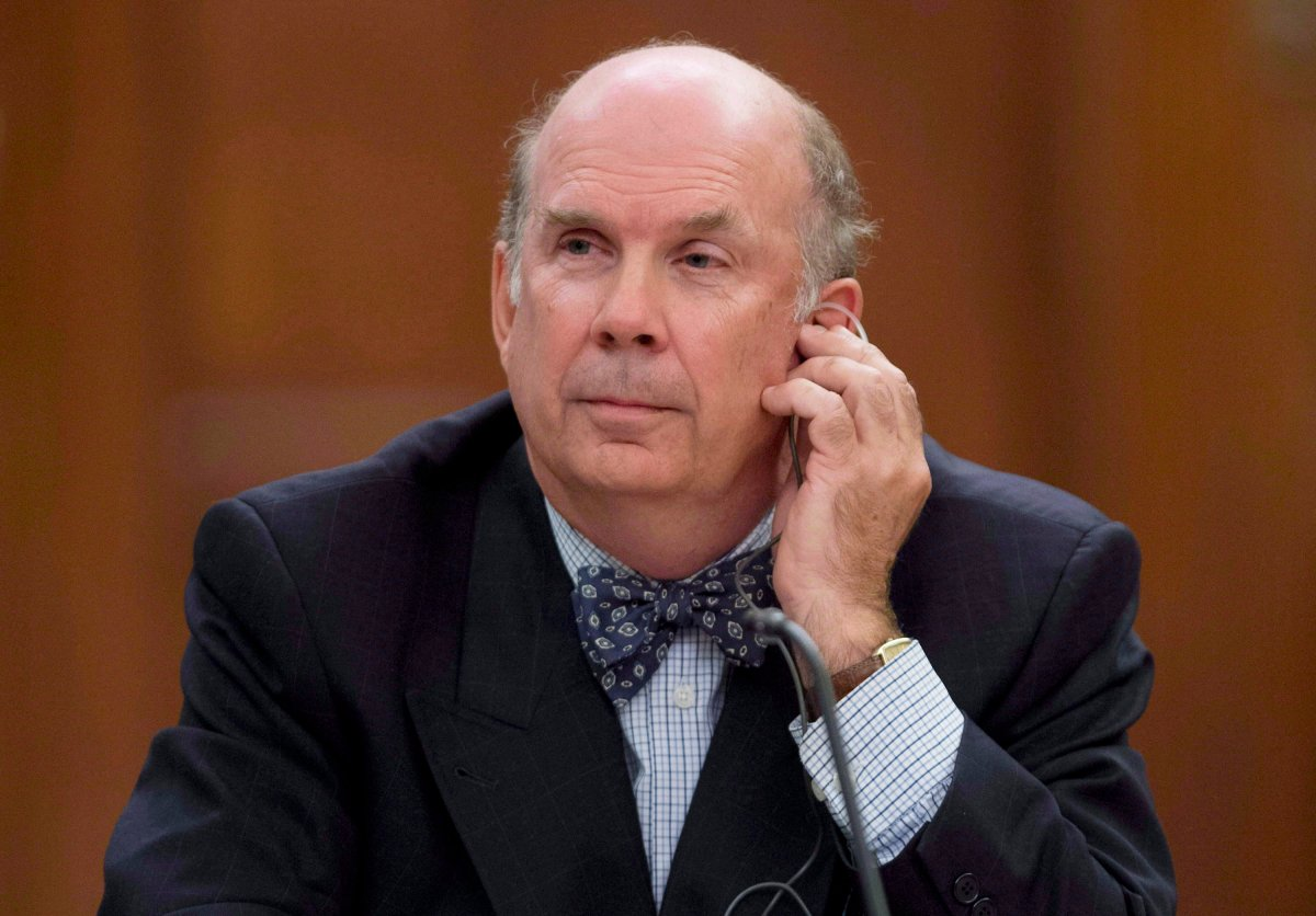 Justice Marc Nadon listens to opening remarks as he appears before a parliamentary committee following his nomination to the Supreme Court of Canada Wednesday October 2, 2013 on Parliament Hill in Ottawa. THE CANADIAN PRESS/Adrian Wyld.