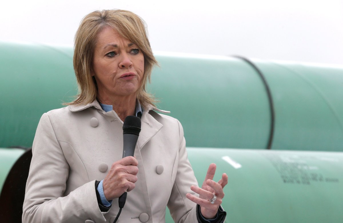 Alberta's energy minister Diana McQueen speaks at the TransCanada pipe yard for the Houston Lateral Project Wednesday, March 5, 2014, in Mont Belvieu, Texas.