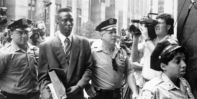 This 1990 file photo provided by Sundance Selects shows accused rapist Yusef Salaam, second right, being escorted by police in New York in 1990. (AP Photo/Sundance Selects, NY Daily News, File).