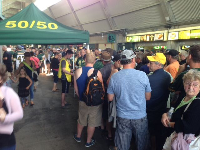 Football fans line up to buy 50/50 tickets at the Edmonton Eskimos game Thursday, July 24, 2014.