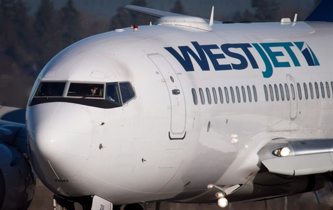 A pilot taxis a Westjet Boeing 737-700 plane to a gate after arriving at Vancouver International Airport in Richmond, B.C., on Monday February 3, 2014. WestJet Airlines is preparing for the arrival of new low-cost competitors including Southwest Airlines by taking steps to expand its regional service and add wide-body planes to its fleet to access new international routes. THE CANADIAN PRESS/Darryl Dyck