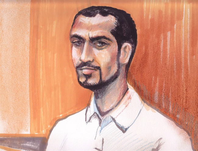 Omar Khadr appears in an Edmonton courtroom, Monday, Sept.23, 2013.