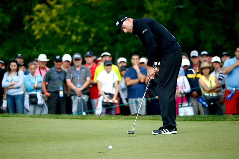 Jim Furyk putts on the fifth hole during the third round of the RBC Canadian Open at the Royal Montreal Golf Club on July 26, 2014 in Montreal, Quebec, Canada. (Photo by Sam Greenwood/Getty Images) .