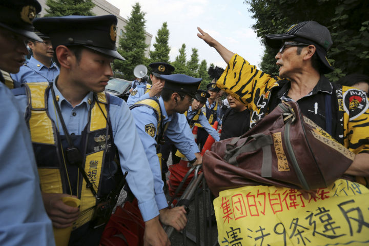 People in Tokyo protest Japan's reinterpretation of Article 9 of the constitution
