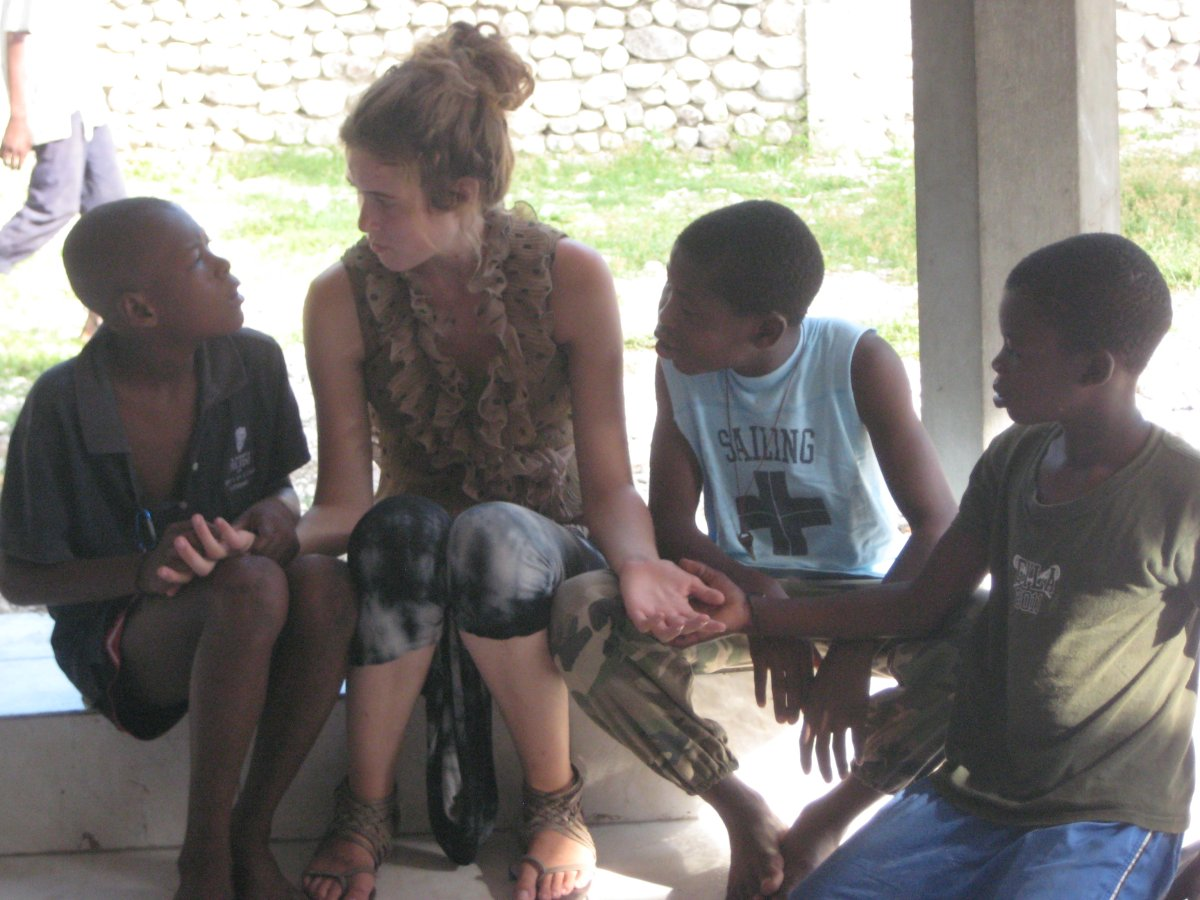 Morgan and children at the Les Cayes transitional safe house. (2013).
