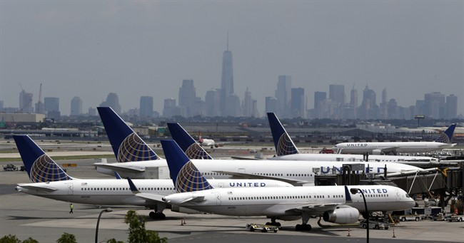 United Airlines jets are parked on the tarmac at Newark Liberty International Airport, Tuesday, July 22, 2014, in Newark, N.J.