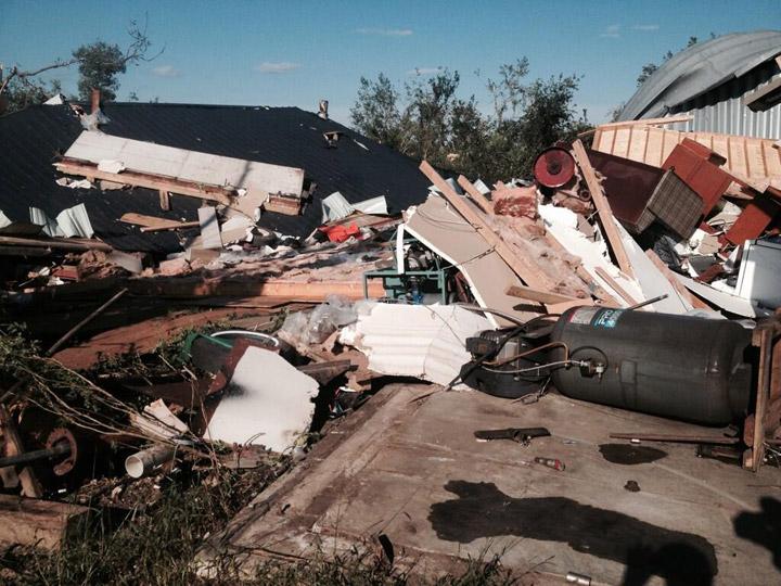 Debris left over after a tornado landed near Outlook, Sask. on July 5, 2014.