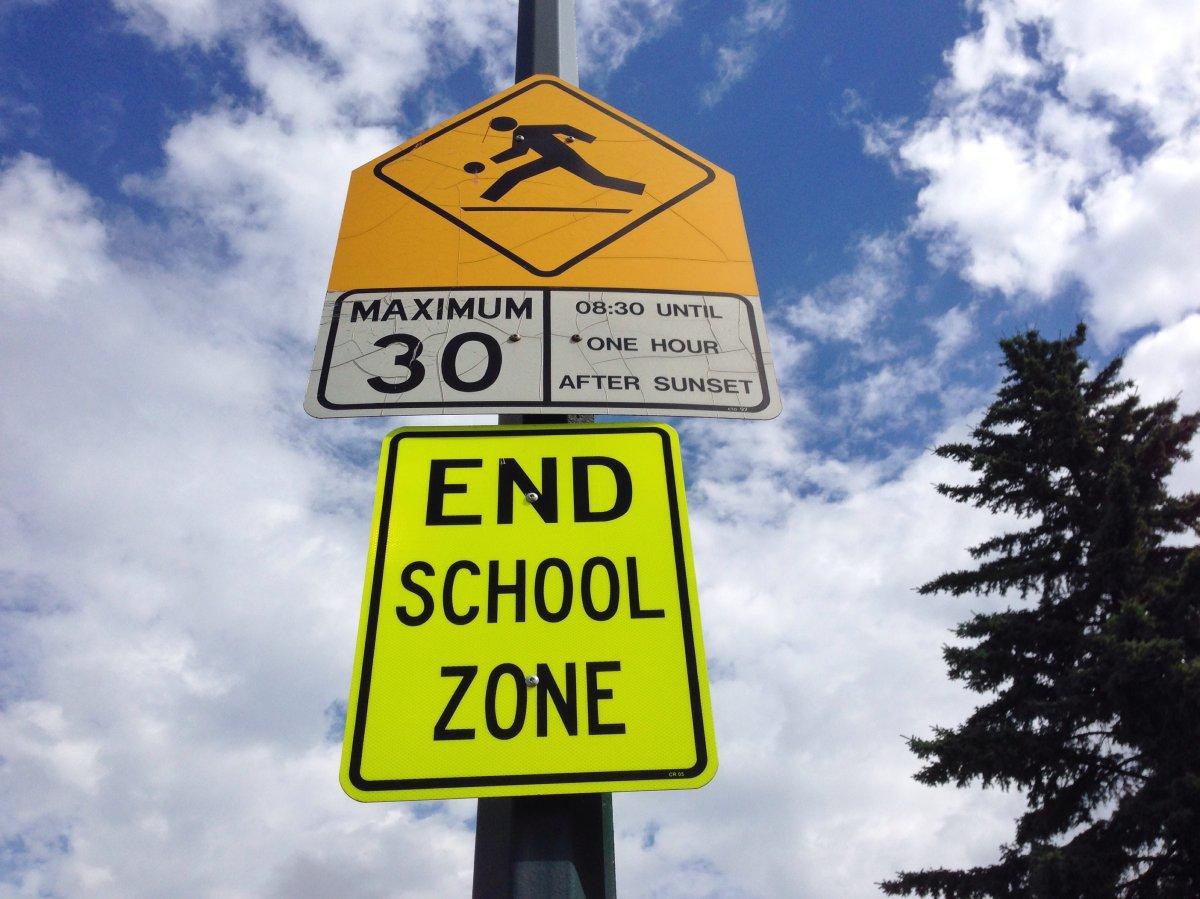 FILE: A school zone sign in Calgary, Alberta.