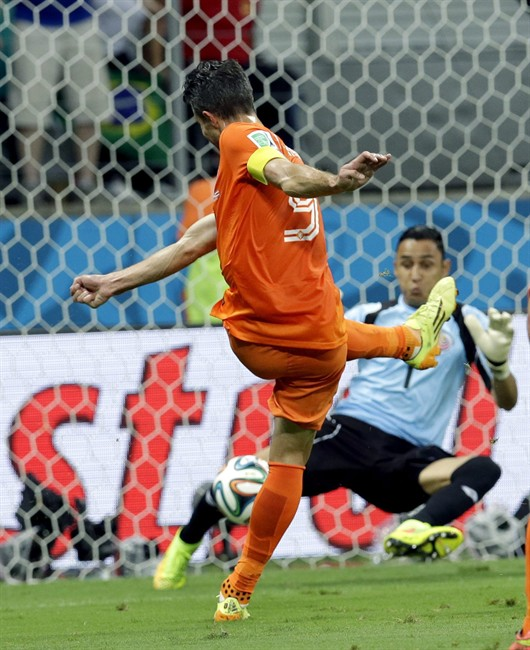 Costa Rica's goalkeeper Keylor Navas (1) stops a shot by Netherlands' Robin van Persie (9) during the World Cup quarterfinal soccer match between the Netherlands and Costa Rica at the Arena Fonte Nova in Salvador, Brazil, Saturday, July 5, 2014.
