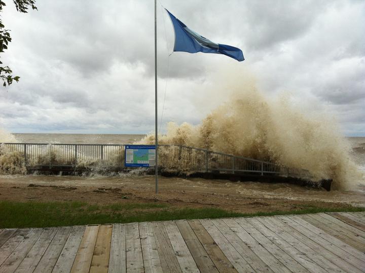 Waves crash ashore at Winnipeg Beach on the west shore of Lake Winnipeg on Canada Day.