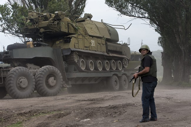 Ukrainian government forces maneuver antiaircraft missile launchers Buk as they are transported north-west from Slovyansk, eastern Ukraine Friday, July 4, 2014. (AP Photo/Dmitry Lovetsky).