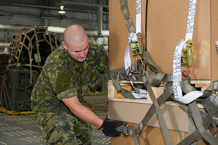Military material boxes containing non-kinetic military equipment for Ukraine are being prepared by the military personnel of 8 Wing, Canadian Forces Base Trenton, Ontario on August 5, 2014.