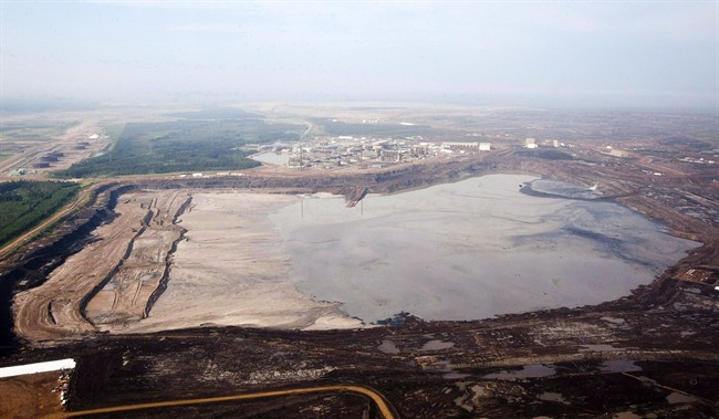 A tailings pond at the Syncrude oilsands facility is seen from a helicopter near Fort McMurray, Alta., July 10, 2012.