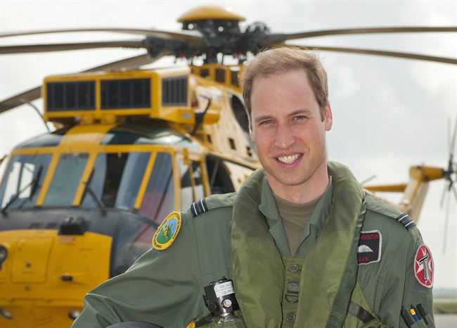 Prince William poses in front of a Sea King helicopter at RAF Valley in Anglesey Wales on June 1, 2012.
