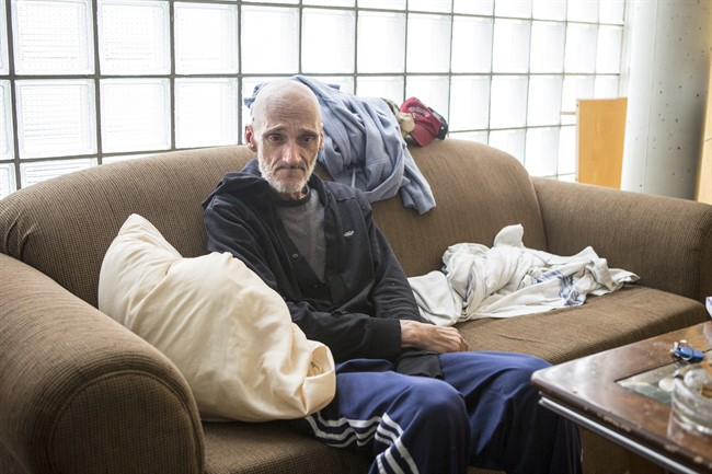 Dan Thibideau sits in his room at Toronto's Fred Victor transitional housing centre on Wednesday, July 30 , 2014. Thibideau, who has cancer, is the first patient of the PEACH (Palliative Education and Care for the Homeless) program.