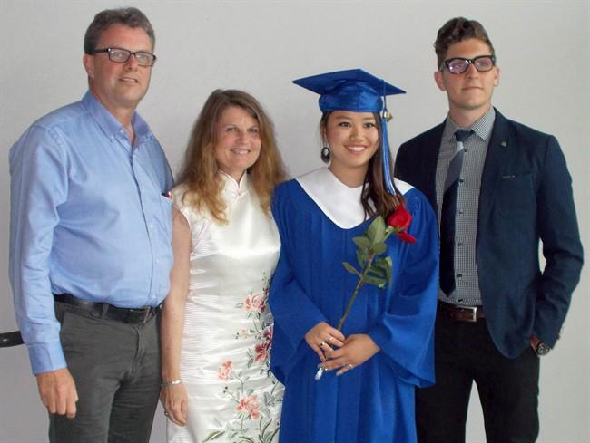 Kevin Garratt, left to right, Julia Dawn Garratt, Hannah Garratt and Simeon Garratt pose in this undated handout photo. THE CANADIAN PRESS/HO - Garratt Family.