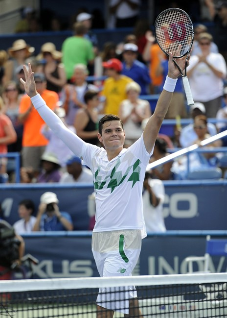 Milos Raonic, of Canada, celebrates after he beat compatriot Vasek Pospisil in the men's singles final at the Citi Open tennis tournament, Sunday, Aug. 3, 2014, in Washington. Raonic won 6-1, 6-4.